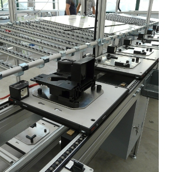 ASSEMBLY LINES<br><br>Production line for manual assembly of household appliances.<br><br>The line consists of individual work areas where the operator performs limited assembly operations, testing and packaging operations supported by equipment that allows simplification of work